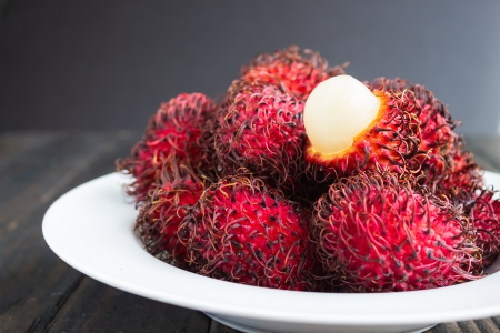 Rambutan is a tropical sweet and sour, white, translucent fruit with a red leathery skin with hairy protuberances.