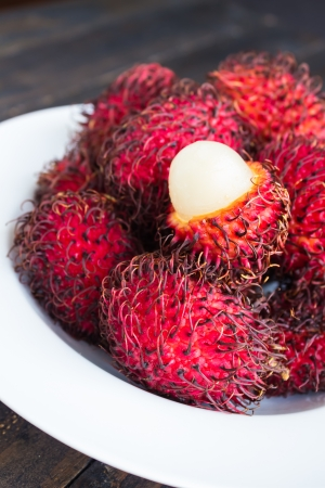 protuberances: Rambutan is a tropical sweet and sour, white, translucent fruit with a red leathery skin with hairy protuberances.