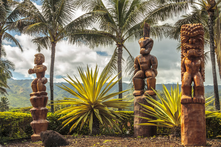 Three wooden Polynesian tiki carvings on Oahu, Hawaii Stock Photo