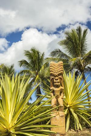 A wooden Polynesian tiki carving on Oahu, Hawaii photo