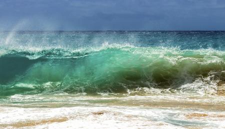 shorebreak: A wave breaking on the shore of Sandy Beach on Oahu, Hawaii Stock Photo