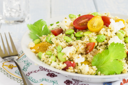 Tabbouleh made with bulgar, edamame, red and yellow cherry tomatoes, green onions, cilantro, crumbled feta cheese and a lemon pesto dressing