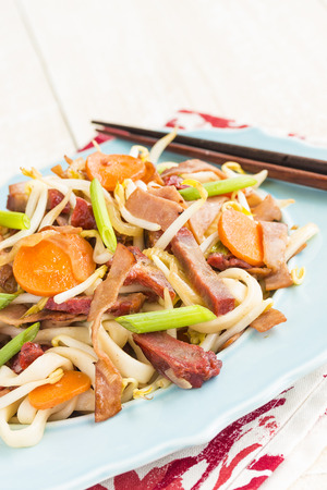 Chow Funn noodles with sauteed ham, char siu pork and vegetables 版權商用圖片