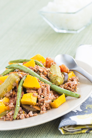 Pinakbet or pakbet is an indigenous Filipino dish from the northern regions of the Philippines made from mixed vegetables and longaniza suasage steamed in fish or shrimp sauce. photo