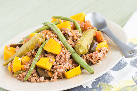 longaniza: Pinakbet or pakbet is an indigenous Filipino dish from the northern regions of the Philippines made from mixed vegetables and longaniza suasage steamed in fish or shrimp sauce. Stock Photo