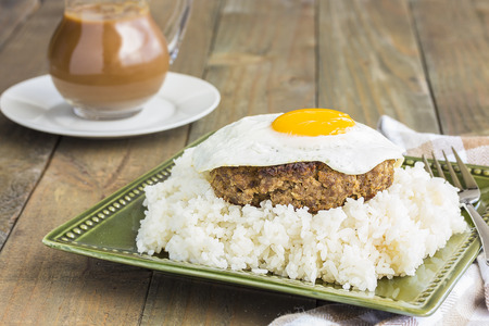 Loco Moco, a traditional Hawaiian dish of teriyaka flavored ground beef patty and a fried egg on a bed of rice, smothered in gravy Stock Photo