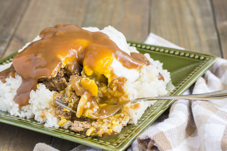 smothered: Loco Moco, a traditional Hawaiian dish of teriyaka flavored ground beef patty and a fried egg on a bed of rice, smothered in gravy Stock Photo