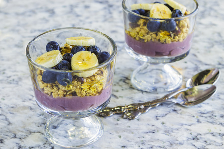 poi: Hawaiian parfait with layers of poi, granola, blueberries, bananas and drizzled with agave