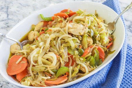 bean sprouts: Chicken stir-fried with carrots, bell pepper, celery and bean sprouts Stock Photo