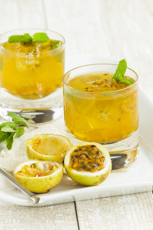 Refreshing summertime Hawaiian cooler with passion fruit juice and mint