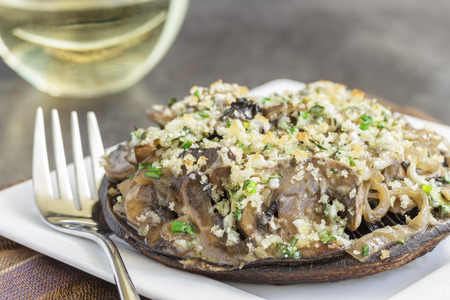 Portobello mushroom caps filled with shallots and cremini mushroom in a white wine cream sauce, broiled with a parmesan, chive and cilantro panko topping photo