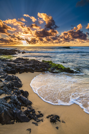Sunrise at the shore of Sandy Beach on Oahu, Hawaii