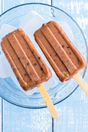 Hawaiian ice pops made with shaved coconut and sweetened adzuki beans photo