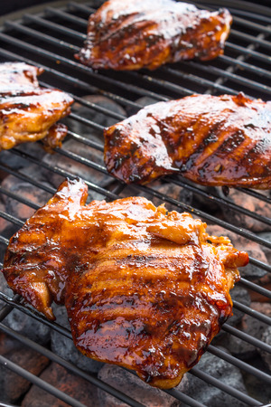 grill chicken: Grilled boneless chicken thighs marinated and basted in a mixture of guava jam shoyu oyster sauce and seasonings Stock Photo