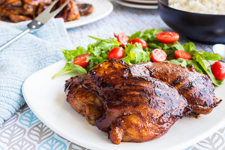 Grilled boneless chicken thighs marinated and basted in a mixture of guava jam shoyu oyster sauce and seasonings Foto de archivo