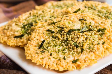 sprinkled: Parmesan baked crispy and sprinkled with furikake seasoning Stock Photo