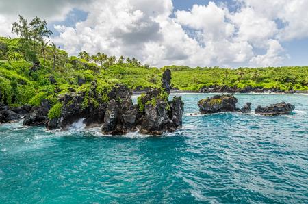 hawaii beach: Waianapanapa State Park, home to a black beach, a popular destination on the Road to Hana on Maui, Hawaii Stock Photo