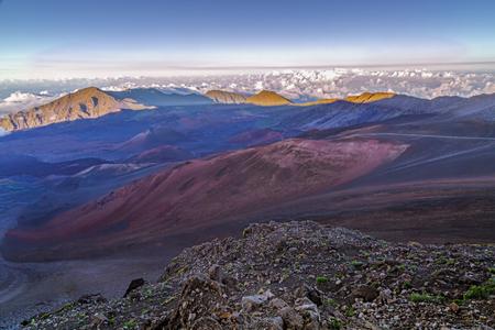 otherworldly: The colorful, otherworldly terrain of Haleakala Crater at sundown on Maui, Hawaii