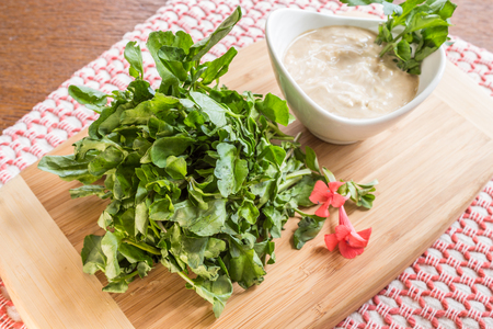 berros: Fresh watercress served with dipping sauce as an appetizer
