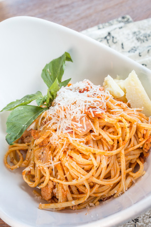 linguine pasta: Linguine pasta tossed in a traditional arrabbiata sauce, served with parmesan and basil garnish Stock Photo