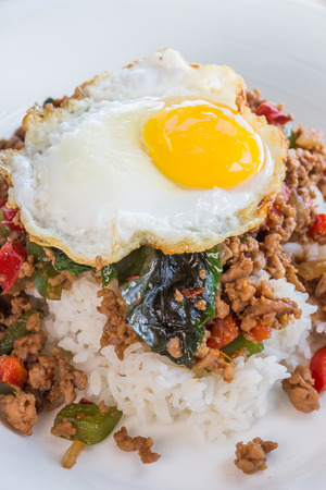 loco: Thai version of loco moco made with rice, a spicy meat and vegetable mixture, topped with a fried egg Stock Photo