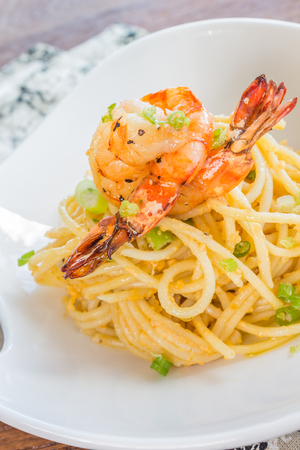linguine pasta: Pasta with sea urchin and fish eggs, topped with sauteed shrimp Stock Photo