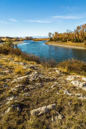The Missouri River flowing through the Missouri Headwaters State Park in Three Forks, Montana