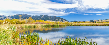 A beautiful reservoir in autumn fields at the foot of the Bridger mountain range in Cherry Creek Nature Preserve on the outskirts of Bozeman, Montana Stock Photo