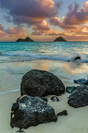 na: Sunrise over Na Mokulua in Lanikai on east Oahu, Hawaii Stock Photo