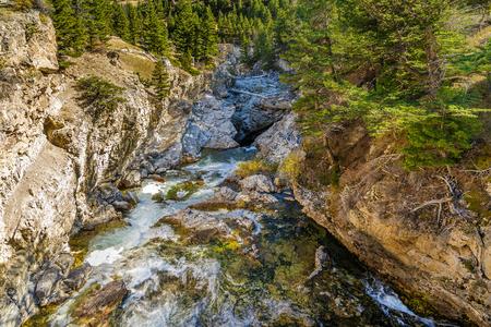 natural bridge: The Boulder river flowing through Natural Bridge State Park in McLeod, Montana Stock Photo
