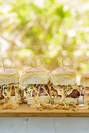 char: Char siu chicken, slaw and dressing on Hawaiian sweet slider buns