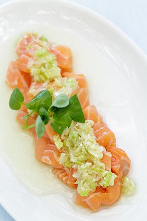 poke: Salmon poke topped with a green onion sauce