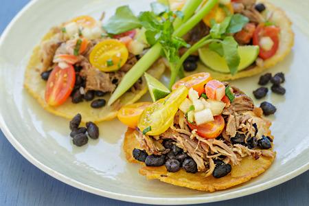 gallo: Mini tostadas with crispy pork, black beans and pico de gallo