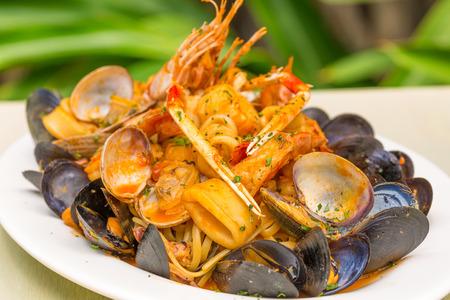 linguine pasta: Linguine pasta tossed with clams, squid and prawns
