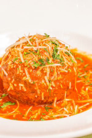 meatloaf: A very large Italian meatball bathed in rich pomodoro sauce, garnished with parmesan and parsley