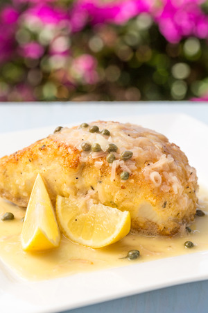 Fresh Ono, or Wahoo, sauteed in a macadamia nut crust with capers and lemon sauce Stock Photo