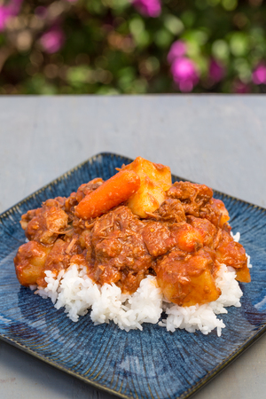 Traditional beef stew served Hawaiian style on a bed of sticky rice