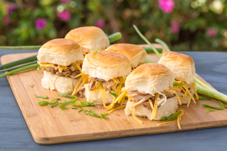 Kalua pork sliders on sweet Hawaiian bread with green onions and carrots