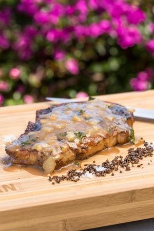 Boneless rib eye steak topped with Steak Diane sauce Stock Photo