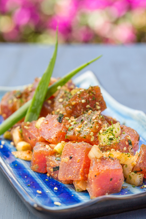 Dices fresh ahi tuna with onions and sprinkled with furikake seasoning