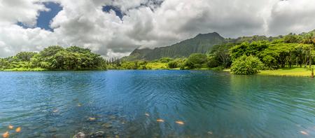 A panoramic view of the lake at Hoomaluhia Botanical Gardens in Kaneohe on Oahu, Hawaii