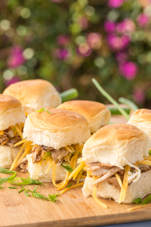 Kalua pork sliders on sweet Hawaiian bread with green onions and carrots
