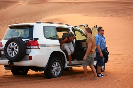 the jeep: Pink Rock Desert Sharjah UAE  OCTOBER 18: Driving on jeeps on the desert traditional entertainment for tourists on October 18 2014 in Pink Rock Desert Sharjah Dubai UAE