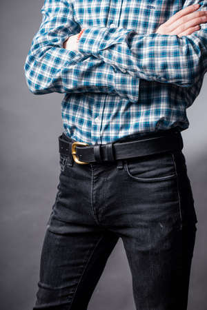 Black leather belt with ash buckle at mens waist Stock Photo