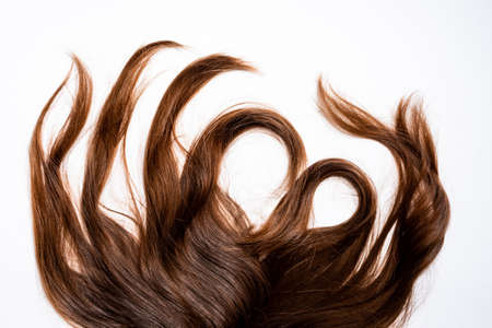 Hair waves curls lie on a white background
