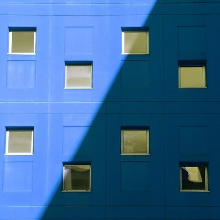 window on the blue facade in Bilbao city. Spain
