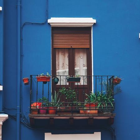window on the blue facade in Bilbao city. Spain.