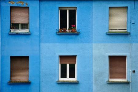 window on the blue facade in Bilbao city spain