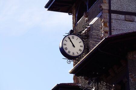 clock on the station building facade in the city