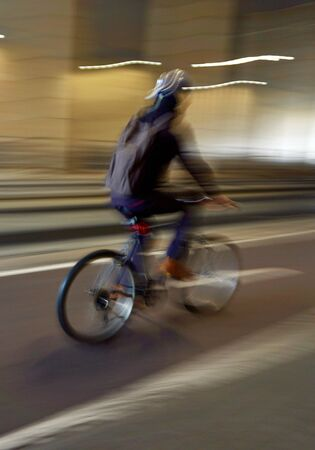 cyclist riding a bike on the street in Bilbao city Spain. mode of transport Foto de archivo